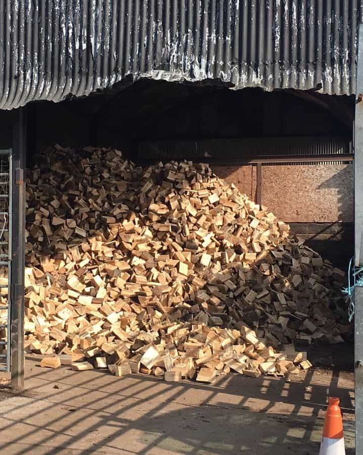 Filling the barn with logs in preparation for next season
